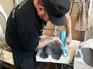 Casey Westbrook applying glue to my mold