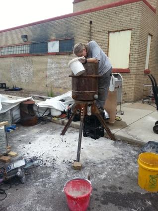 Rachel Wolski cleaning the furnace